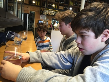 Three boys just told off for misbehaving in a cafe